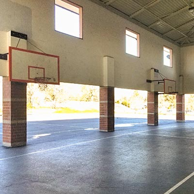 Photo of covered basketball hoops and court.