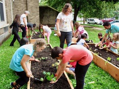 Children gardening in garden boxes.