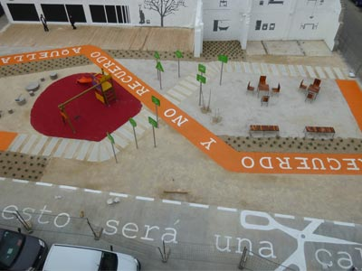 A playground surface painted with Spanish words.