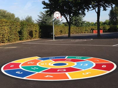 A spiral game painted on a playground surface.