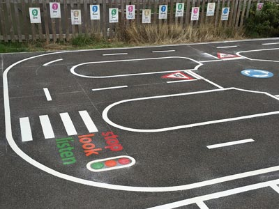 A traffic track painted on a playground surface.