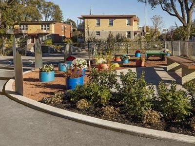 Garden boxes next to a playground.