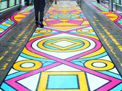 A play surface painted with a brightly-colored pattern.