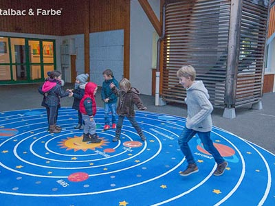 A playground surface painted with a diagram of the solar system.