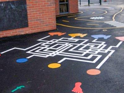 A playground surface painted with a maze.
